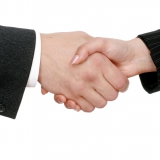 Shaking hands in agreement