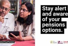 A couple reviewing their pension documents