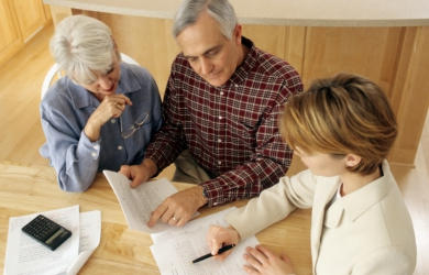 Couple discussing pension arrangements with an advisor